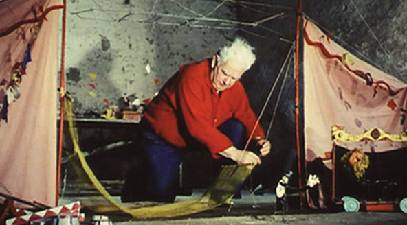 "© Alexander Calder with Calder Circus, still image from Carlos Vilardebo's 1961 film of Alexander Calder's ""circus"". Courtesy of Fondation Calder."